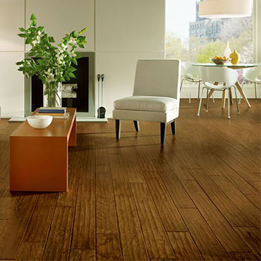 Bruce hand-scraped hardwood flooring has a time-worn appearance. The color finish complements any design – from rustic to modern.